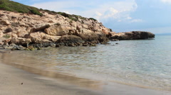 Sea shore in south Sardinia, Italy, with beach, rocks, and natural landscape Stock Footage