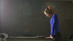 young woman with the gun on an indoor shooting range. collect gun - stock footage