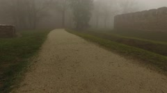 Foggy Footpath And Ancient Walls Stock Footage