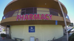 Pharmacy Sign On Side Of Small Round Building - Zoom Santa Ana CA - stock footage