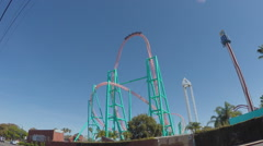 Roller Coaster Over Peak Then Downhill - Buena Park CA Stock Footage