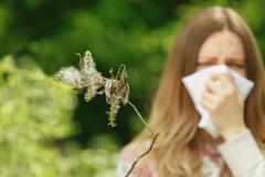 young woman suffering spring pollen allergy - stock photo