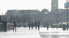 Adults and children walking along the promenade in beautiful European city Stock Footage