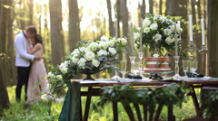 Romantic dinner in rustic style outdoor. Young couple in love softly kissing on Stock Footage