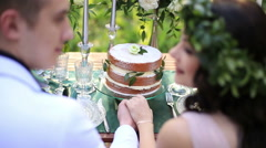 Beautiful young couple held hands on romantic dinner man and woman on served Stock Footage