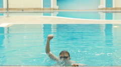 Champion emerges from the pool Stock Footage