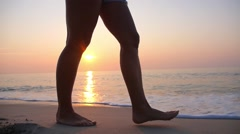 Woman Legs Walking on Beach by Sea in Sunset. Slow Motion. Stock Footage