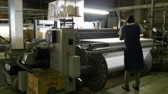 TEXTILE FACTORY - BARCELONA: woman fixing machine factory Stock Footage