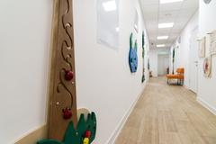 Children's Medical Center with educational games on walls - stock photo