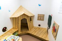 Children's playroom with house and educational toys - stock photo