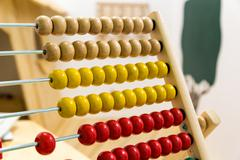 Children's abacus in game room - stock photo