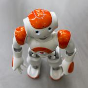 Small robot with human face and body. AI - stock photo