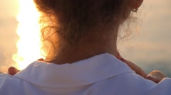 Woman Staying Back of Head in Summer Sunset by Sea Stock Footage