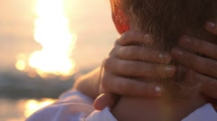 Closeup Sensual Woman Back at Sea Sunset with Hands on Neck - stock footage