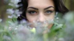 Close up face of young beautiful woman posing to camera surrounded by spring Stock Footage