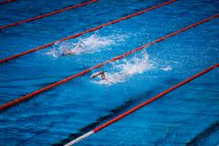 Swimming pool with swimmer crawl race - stock photo
