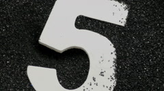 Wooden number 5 in sand. Stock Footage