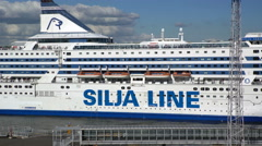 """Large sea ferry """"Silja Line"""" departs from the pier in the port of Helsinki. Stock Footage"""