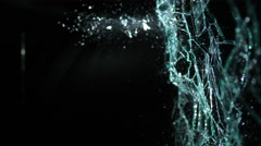Slow Motion Glass Shattering From Right-To-Left Over Black Background in 4k Stock Footage