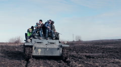 Military Entertainment. People Riding From Above On The Old Tank Stock Footage