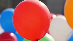 Color helium balloons fly. - stock footage