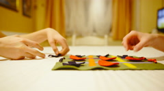 Two players finished playing tic tac toe and rolling together cloth 4K Stock Footage
