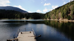 Amazing view of the small old wooden pier and landscape of forest, lake - stock footage