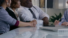 Close up shot of business man talking with colleagues at an office meeting - stock footage