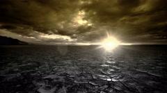 Tracking Sunrise Time Lapse across apocalyptic desert playa wasteland - stock footage