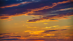 The stream of cloud on the background of sunset. Time lapse Stock Footage