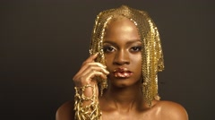 Surreal Portrait of Sexy African American Woman with Glossy Golden Makeup and Stock Footage