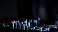 DJ mixer in the club in the rays of light on the background of dancing DJ loop - stock footage