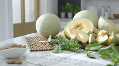 Cantaloupe recipes on kitchen worktop dolly right - stock footage