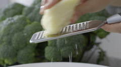Grating parmesan cheese fast - stock footage