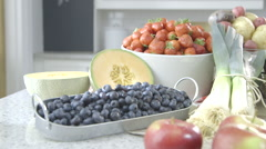 Fruits and Vegetable display on a kitchen worktop dolly right Stock Footage