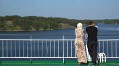 Family admires Scandinavian landscapes from the deck of a large sea ferry Stock Footage