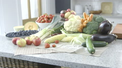Fruits and Vegetable display on a kitchen worktop dolly right - stock footage