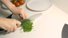 Woman choppe green dill at the cutting board Stock Footage