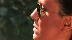 Girl with sun glasses talking 02 Arkistovideo