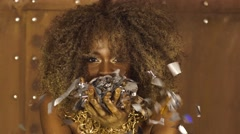Close-up portrait of sexy african american female model with gold glossy makeup Stock Footage