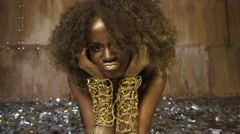 Creative surreal portrait of sexy african american female model with gold glossy - stock footage