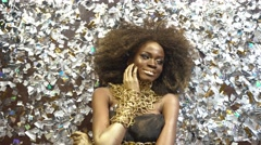 Creative surreal portrait of sexy african american female model with gold glossy Stock Footage