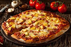 Homemade Pineapple and Ham Hawaiian Pizza Stock Photos