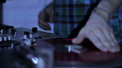 DJ scratching vinyl records and mixing on the Decks at a disco in Nightclub Stock Footage