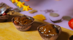 The decoration of chocolate tartlets Stock Footage