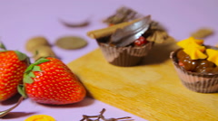 The decoration of chocolate tartlets - stock footage