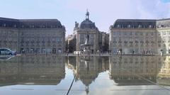 Tourists walking at famous Place de la Bourse square in Bordeaux, France Stock Footage