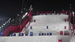 Mogul skiing World Cup in Moscow Russia. Two sportsman competition - stock footage