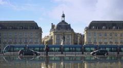 City traffic near Place de la Bourse square in Bordeaux, famous architecture Stock Footage