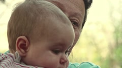 Grandmother carying her granddaughter - stock footage